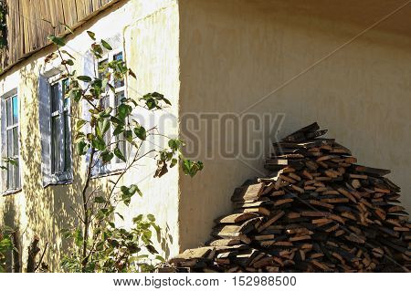 the walls are made timber, chopped wood of the slab in the village for furnace, countryside