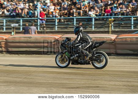 Rivne Ukraine - 29 August 2015: Unknown stunt biker entertain the audience before the Open Cup Speedway to the day of the city Rivne