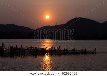 Sunset over lake in Thailand near Hua Hin