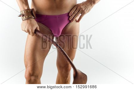 BDSM man - handcuffs and whip - sexual aggression