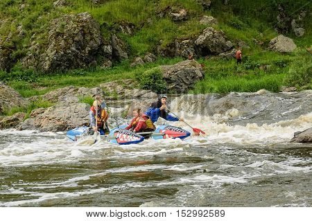 Beklenischevo, Russia - June 12, 2005: The place with the Iset River rapid current, a so-called threshold the Revun - Howler . Water sportsmen move in threshold