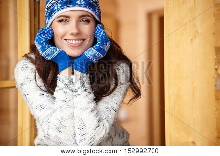 woman resting after a winter sports on the terrace of the house