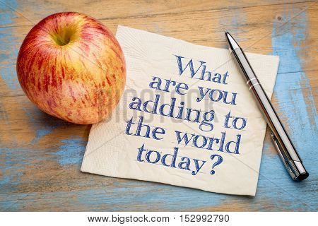 What are adding to the world today? Handwriting on a napkin with a fresh apple
