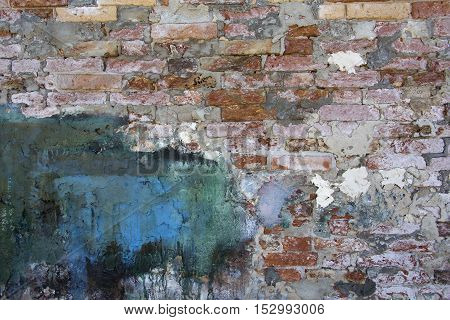 Textured background old brick wall pattern in Burano Italy