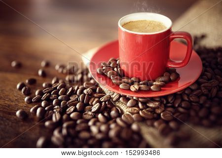 Coffee cup espresso with burlap sack and roasted beans