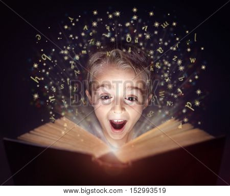 Child reading a magical story book with letters leaping off the page