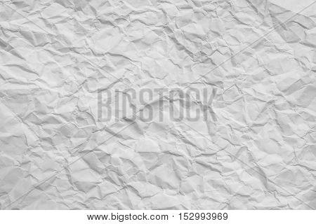Texture of crumpled bright paper. Closeup photo.