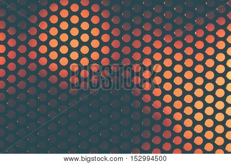 Perforated grating on the background color blurred abstract backdrop