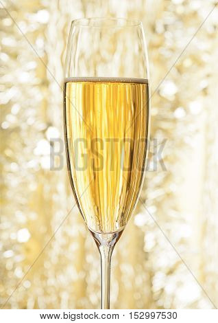 Glass of champagne on bokeh background for celebration