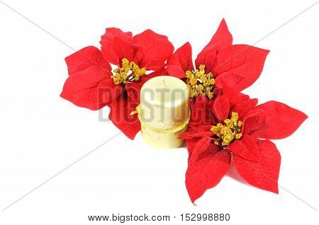 Golden candle  with poinsettia flowers isolated on white