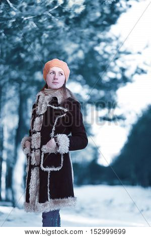 Beautiful Young Woman Standing Looks Away Wearing A Brown Coat Beret Hat In Winter Cold Snowy Scandi