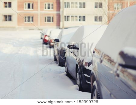 Cars Covered With Snow On Stree In Winter Day
