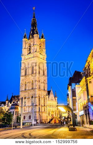 Gent Belgium. The historic center of Ghent embankment Graslei and Belfry Tower at night. Former center of the medieval harbor. Flanders.
