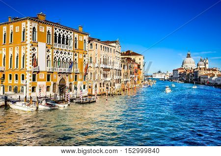 Venice Italy. Gorgeous view of the Grand Canal and Basilica Santa Maria della Salute during sunset with interesting clouds.
