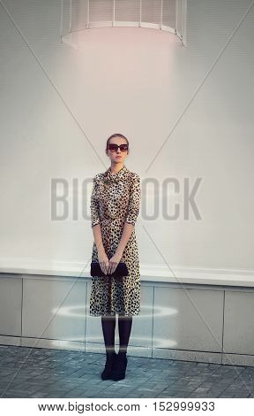 Fashion, Technology And People Concept - Futuristic Woman In Dress With Leopard Print Clutch Handbag