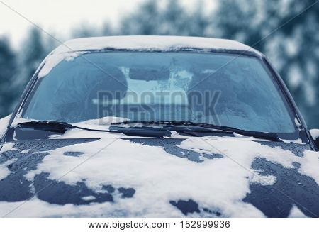 Frozen сar Covered Snow In Winter Day, View Windshield Hood