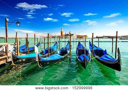 Venice Italy. Gondolas in Grang Canal San Marco Square with San Giorgio di Maggiore church in the background.