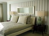 image of master bedroom  - Stylish pale blue and white bedroom in the master suite - JPG