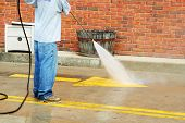 picture of cleaning service  - A Crew Member Cleans The Painted Street Markings - JPG