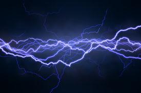 stock photo of lightning bolt  - Lightning extends horizontally across a black background - JPG
