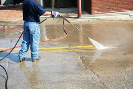 pic of pressure-wash  - Crew Member Cleans The Painted Street Markings - JPG