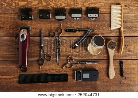poster of Top View Of Various Professional Barber Tools On Wooden Surface In Hair Salon