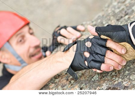 The Help Two Rock-climbers Each Other In Outdoor