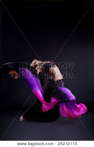 Woman dance with flying fantail and purple fabric