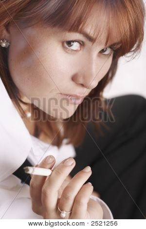 Businesswoman With Cigarette