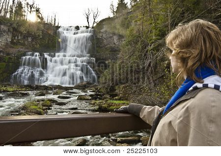 woman overlooking falls