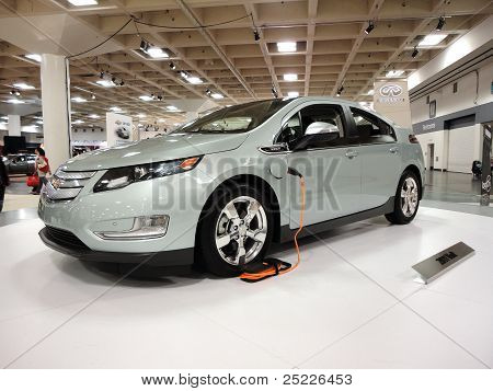 Plug-in Hybrid Car The Chevy Volt On Display On A Spinning Platform