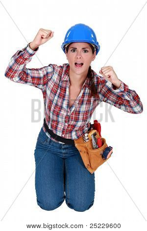 craftswoman kneeling and raising fists