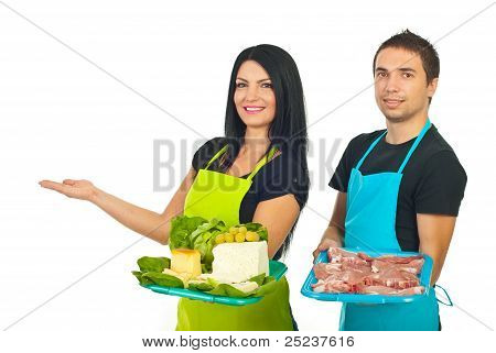 Two Market Workers Making Presentation