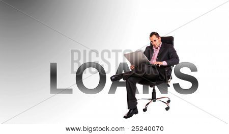 Smiling businessman sitting in front of the word loans