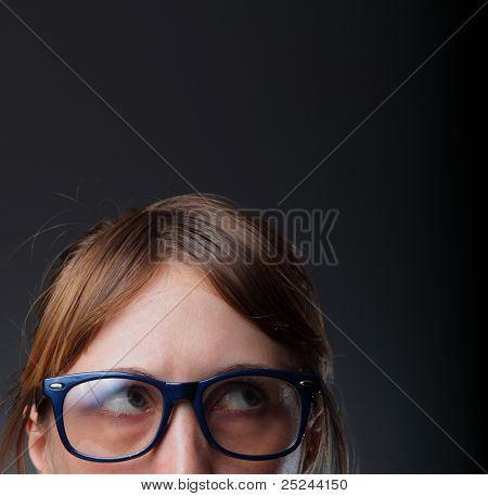 Nerd woman in glasses reading a book