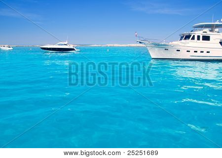 Luxury yacht in turquoise beach of Formentera Illetes