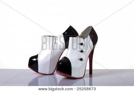 Sexy modern female shoes, studio shot on white background