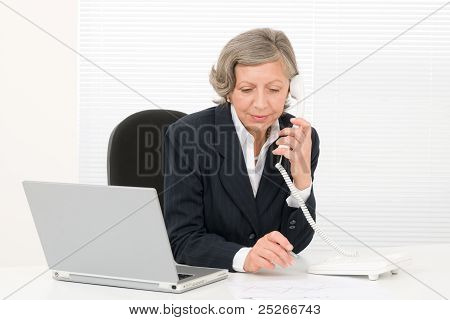 Senior Businesswoman Serious Sit Behind Office Desk