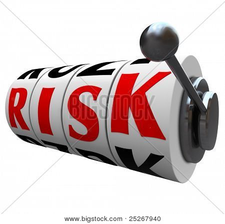 The word Risk appears on slot machine wheels symbolizing the odds and danger of gambling, or investing your income in the stock market, bonds or other form of speculative investments