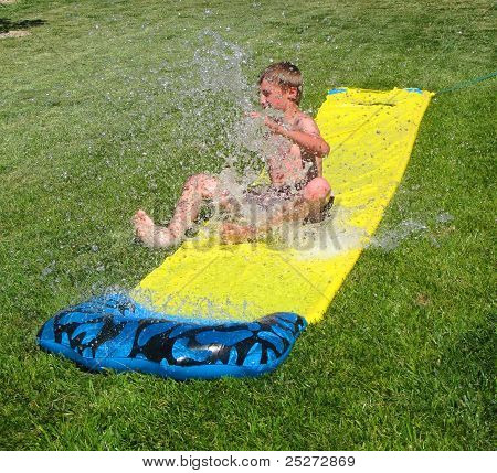 Boy Sliding Through Water