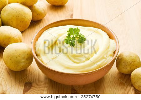 Bowl with mashed potatoes decorated with potatoes