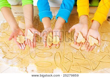 Child's Hands With Dough Over The Table