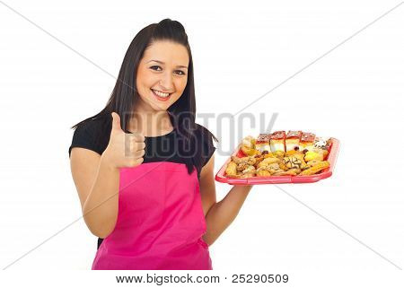 Confectioner With Cakes Giving Thumbs