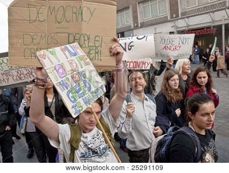 Occupy Exeter Supporters And Participants March Through Exeter City Centre With Placards During The