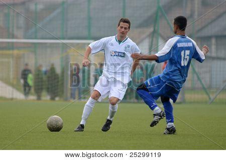 KAPOSVAR, HUNGARY - NOVEMBER 6: Daniel Pager (white 3) in action at the Hungarian National Championship under 19 game Kaposvar (white) vs. Nagybajom (blue) November 6, 2011 in Kaposvar, Hungary.