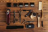 Top View Of Various Professional Barber Tools On Wooden Surface In Hair Salon poster