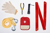 Flat Lay With First Aid Kit And Automotive Accessories Isolated On White poster