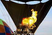 Hot Air Balloon Being Inflated In Preparation For Flight. Gas Burner Fills The Canopy Of A Balloon W poster