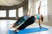 Group Workout, Yoga, Pilates, Fitness, Muscle Power, Activity And Healthy Lifestyle. Young Fit Women poster