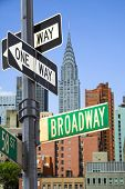 image of broadway  - Broadway sign in front of New York City skyline